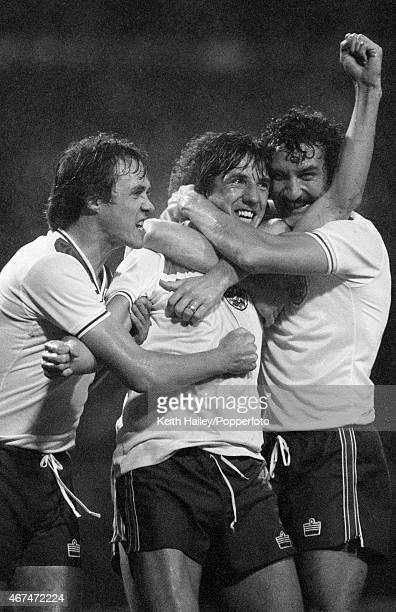 Paul Mariner celebrates with Phil Neal and Terry McDermott after scoring England's winning goal during the World Cup Qualifying match between England...