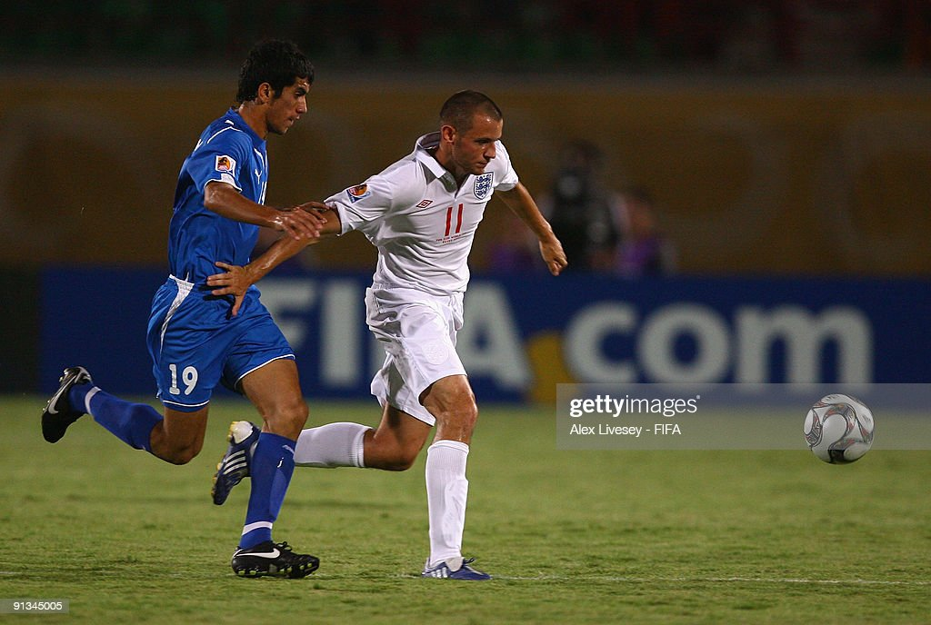 Paul Marshall of England beats Jasur Khasanov of Uzbekistan during the FIFA U20 World Cup Group D match between Uzbekistan and England at the Mubarak Stadium on October 2, 2009 in Suez, Egypt.