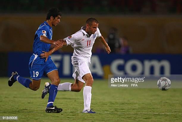 Paul Marshall of England beats Jasur Khasanov of Uzbekistan during the FIFA U20 World Cup Group D match between Uzbekistan and England at the Mubarak...