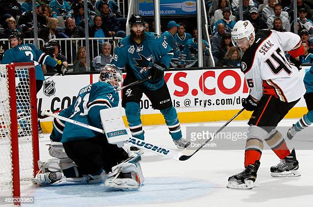 Paul Martin and Brent Burns of the San Jose Sharks watches as Martin Jones makes the save against Jiri Sekac of the Anaheim Ducks during a NHL game...