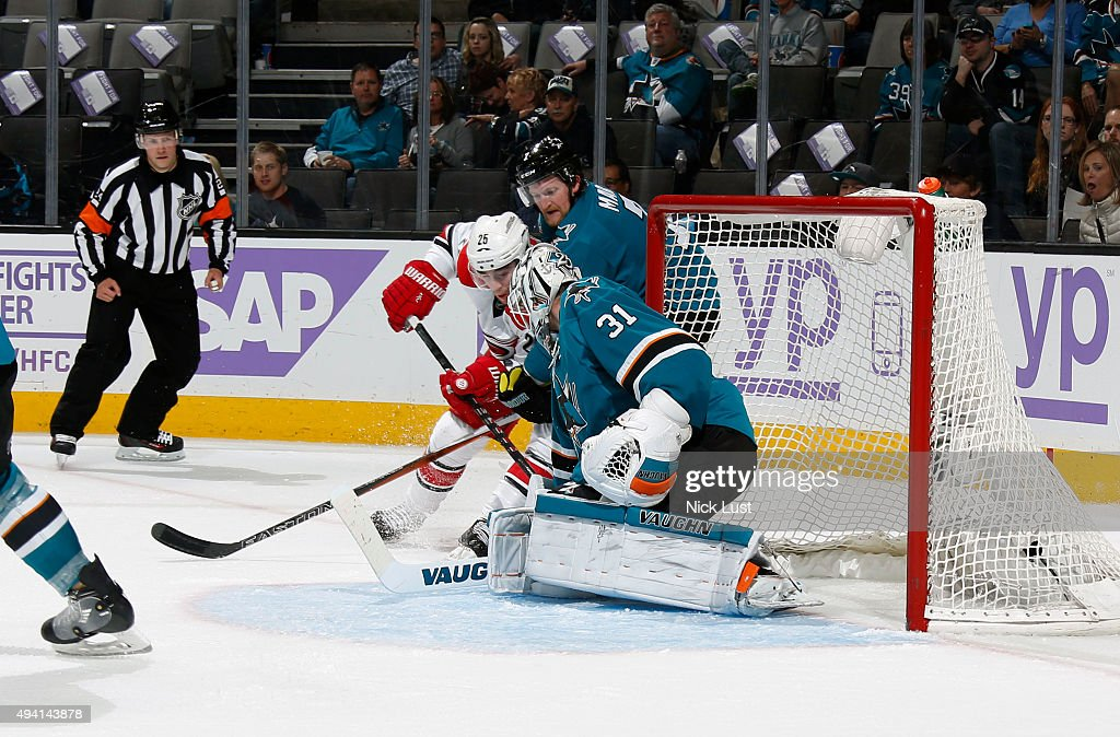 Paul Martin #7 and Martin Jones #31 of the San Jose Sharks protect the net against Chris Terry #25 of the Carolina Hurricanes during a NHL game at the SAP Center at San Jose on October 24, 2015 in San Jose, California.