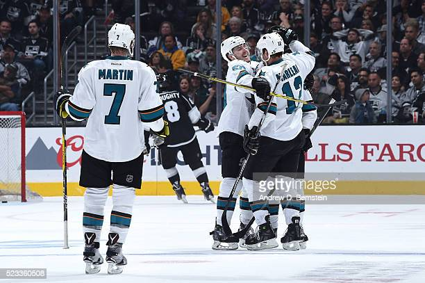 Paul Martin Chris Tierney and Patrick Marleau of the San Jose Sharks celebrate in Game Five of the Western Conference First Round against the Los...