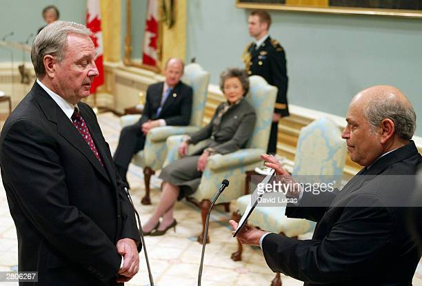 Paul Martin is sworn in as Canada's 21st Prime Minister by the Clerk of the Privy Council Alex Himelfarb at a ceremony at Rideau Hall December 12...