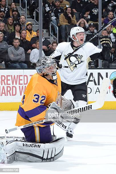 Paul Martin of the Pittsburgh Penguins celebrates as Jonathan Quick of the Los Angeles Kings looks on at STAPLES Center on March 07 2015 in Los...
