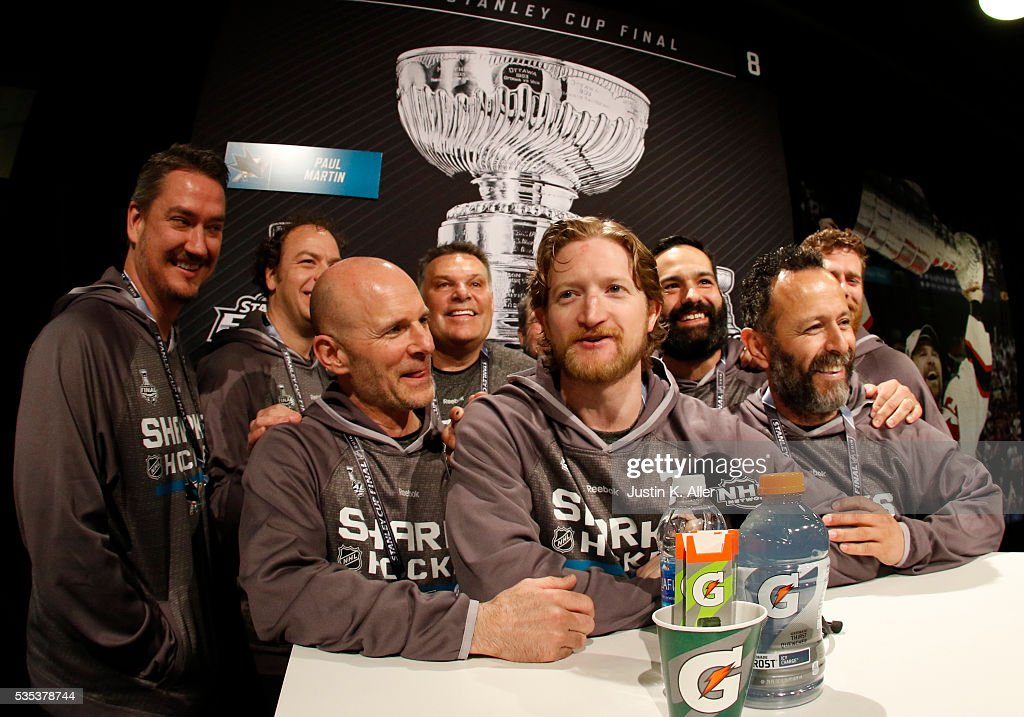 Paul Martin #7 of the San Jose Sharks addresses the media with staff members at his side during the NHL Stanley Cup Final Media Day at Consol Energy Center on May 29, 2016 in Pittsburgh, Pennsylvania.