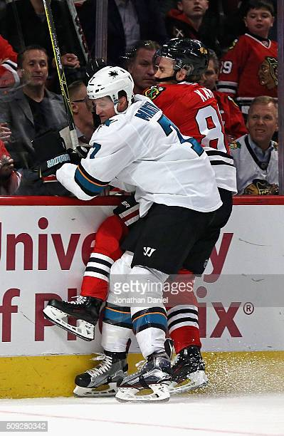 Paul Martin of the San Jose Sharks checks Patrick Kane of the Chicago Blackhawks into the boards at the United Center on February 9 2016 in Chicago...