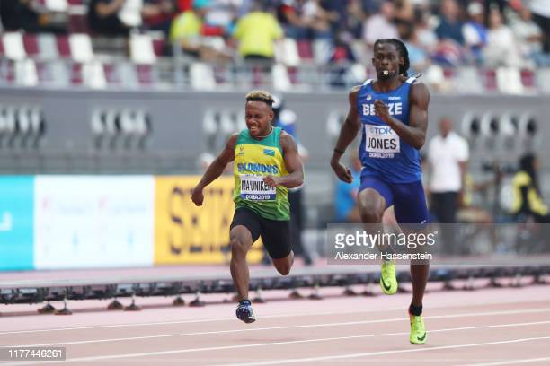 Paul Ma'unikeni of Solomon Islands and Brandon Jones of Belize compete in the Men's 100 metres preliminary round during day one of 17th IAAF World...