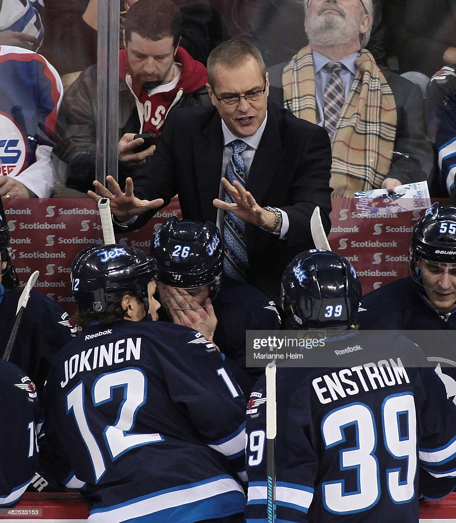 Paul Maurice, in his first game as head coach of the Winnipeg Jets, gestures from the bench in first-period action in an NHL game against the Phoenix Coyotes at the MTS Centre on January 13, 2014 in Winnipeg, Manitoba, Canada.