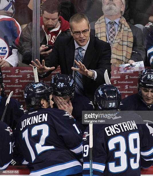 Paul Maurice, in his first game as head coach of the Winnipeg Jets, gestures from the bench in first-period action in an NHL game against the Phoenix...