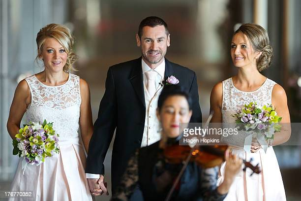 Paul McCarthy along with flower girl Amanda Wenham and matron of honour Tracey Moloney arrives for his wedding ceremony at the Museum of New Zealand...