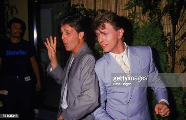Paul McCartney and David Bowie pose for photographers backstage at the Live Aid charity concert, Wembley Stadium, London, 13th July 1985.