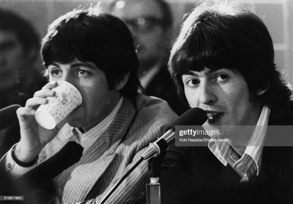 Paul McCartney And George Harrison Of The Beatles Answer Questions At A Press Conference Backstage