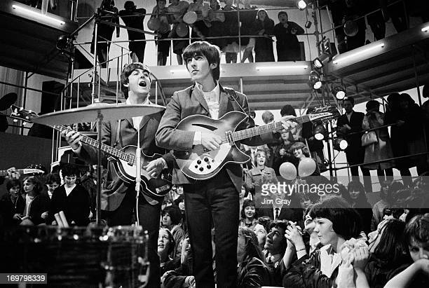 Paul McCartney and George Harrison of The Beatles performing at a rehearsal for the 'Round The Beatles' TV show at the Rediffusion TV studios in...