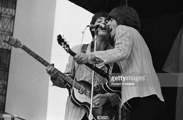 Paul McCartney and George Harrison performing with the Beatles at the Rizal Memorial Football Stadium Manila Philippines during the group's final...
