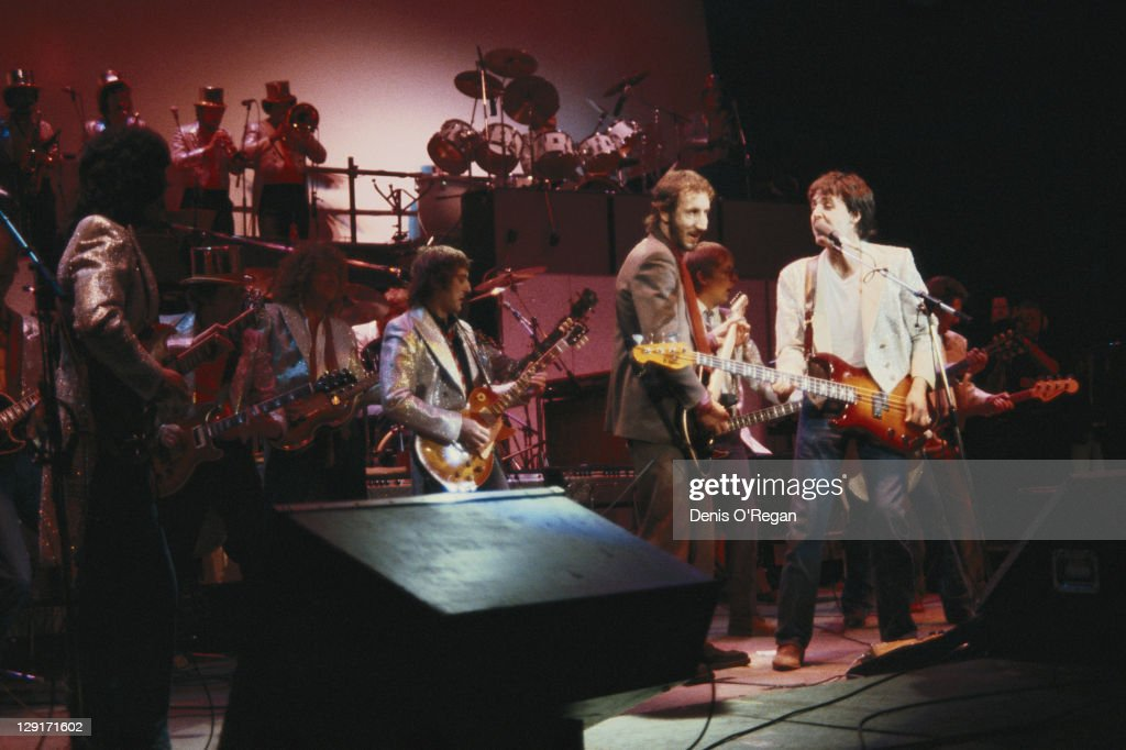 Paul McCartney (far left) and guitarist Pete Townshend of The Who performing with the Rockestra supergroup at one of the Concerts for the People of Kampuchea at the Hammersmith Odeon, London, 29th December 1979.