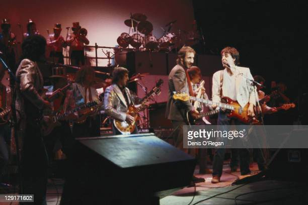 Paul McCartney and guitarist Pete Townshend of The Who performing with the Rockestra supergroup at one of the Concerts for the People of Kampuchea at...