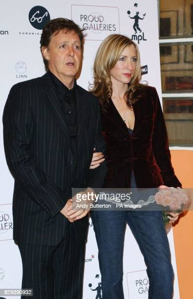 Paul McCartney and his wife Heather MillsMcCartney arrive for the opening of photographic exhibition 'Each One Believing' at the Proud Galleries in...