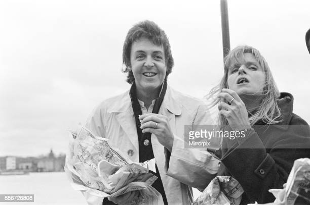 Paul McCartney and his wife Linda of pop group Wings sailing down the River Thames together with Denny Laine as the three of them promote the band's...