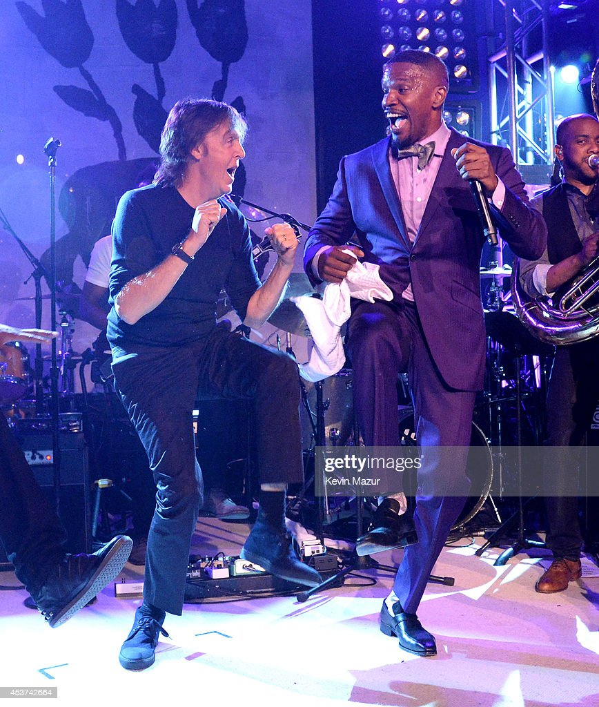 Paul McCartney and Jamie Foxx dance onstage at Apollo in the Hamptons at The Creeks on August 16, 2014 in East Hampton, New York.