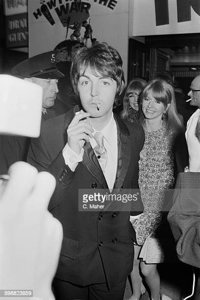 Paul McCartney and Jane Asher attend the premiere of the film 'How I Won The War', London, UK, 18th October 1967. Model Pattie Boyd is just visible...