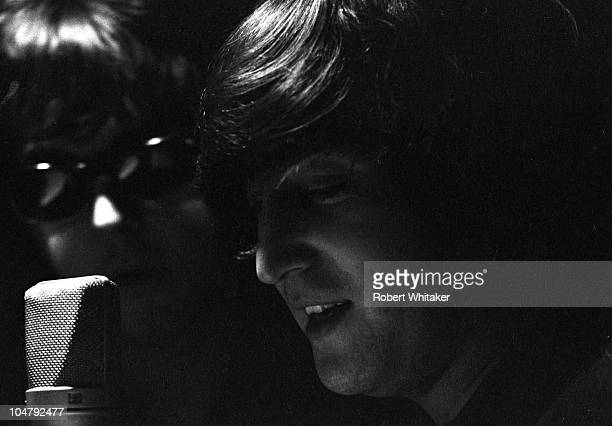 Paul McCartney and John Lennon are pictured during the recording of The Beatles annual Christmas message to their fan club at Marquee Studios in...