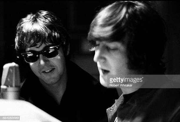 Paul McCartney and John Lennon of The Beatles pictured during the recording of their annual Christmas message to the groups' fan club at the Marquee...