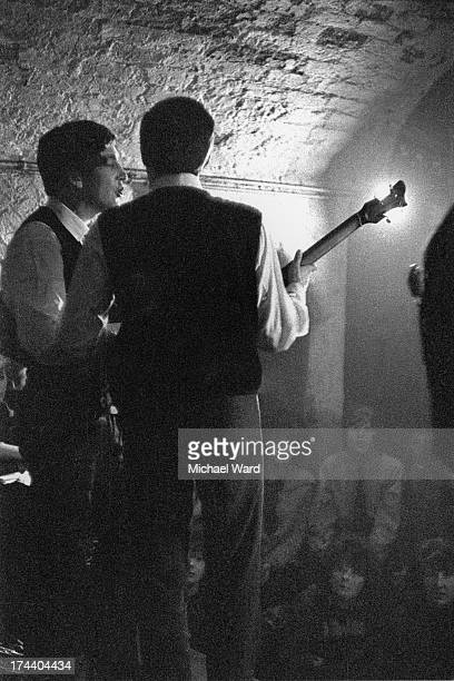 Paul McCartney and John Lennon performing with The Beatles at the Cavern Club Liverpool 1st February 1963