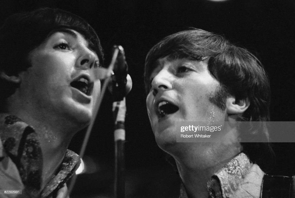 Paul McCartney (left) and John Lennon (1940 - 1980) performing with the Beatles at the Rizal Memorial Football Stadium, Manila, Philippines, during the group's final world tour, 4th July 1966.