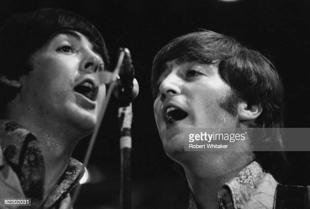 Paul McCartney and John Lennon performing with the Beatles at the Rizal Memorial Football Stadium Manila Philippines during the group's final world...