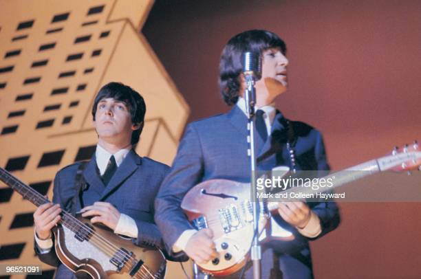 Paul McCartney and John Lennon performing with The Beatles during their American tour August 1965