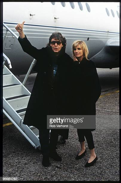 Paul McCartney and Linda McCartney arrive at Zestienhoven Airport in Rotterdam Holland on November 07 1989