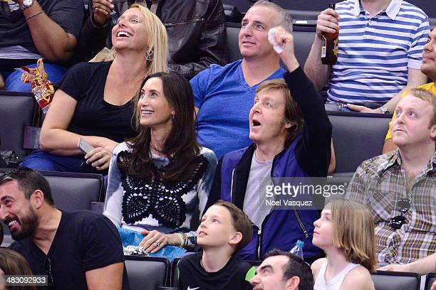 Paul McCartney and Nancy Shevell attend a basketball game between the Los Angeles Clippers and the Los Angeles Lakers at Staples Center on April 6...