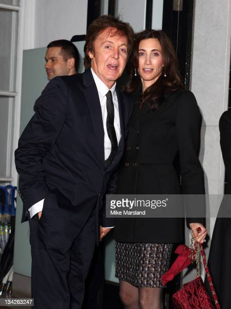 Paul McCartney and Nancy Shevell attend the Christmas light switchon ceremony at Stella McCartney on November 29 2011 in London England