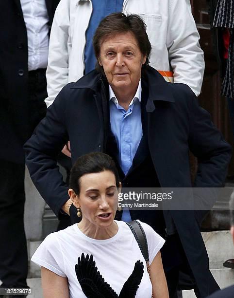 Paul McCartney and Nancy Shevell attend the Stella McCartney show at L'Opera de Paris during Paris Fashion Week Womenswear Spring/Summer 2014 on...