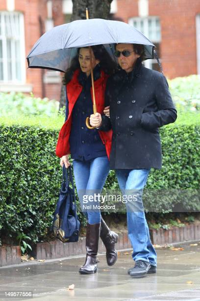 Paul McCartney and Nancy Shevell seen walking in the rain in St John's Wood on July 31 2012 in London England