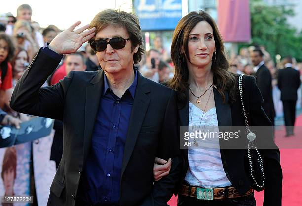 Paul McCartney and partner Nancy Shevell arrive to attend 'George Harrison Living In The Material World' film documentary UK premiere at BFI...