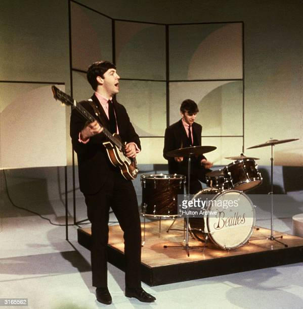 Paul McCartney and Ringo Starr of The Beatles performing during an early television performance on 'Thank Your Lucky Stars' on February 17th 1963