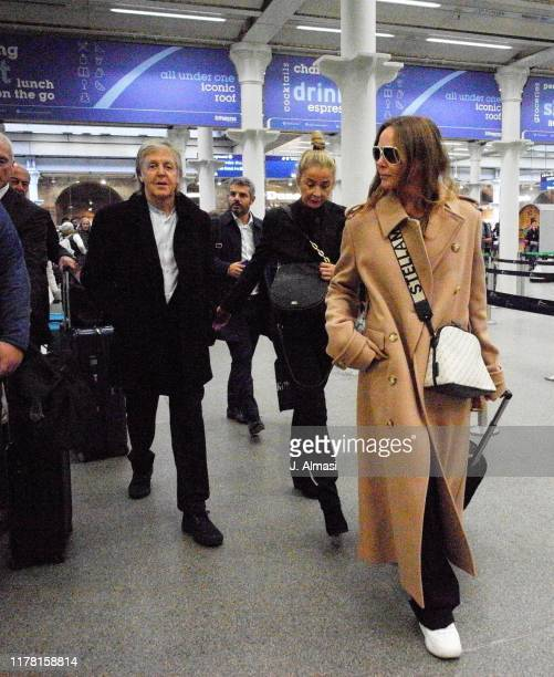 Paul McCartney and Stella McCartney arriving at Kings Cross St Pancras from Paris on September 30 2019 in London England
