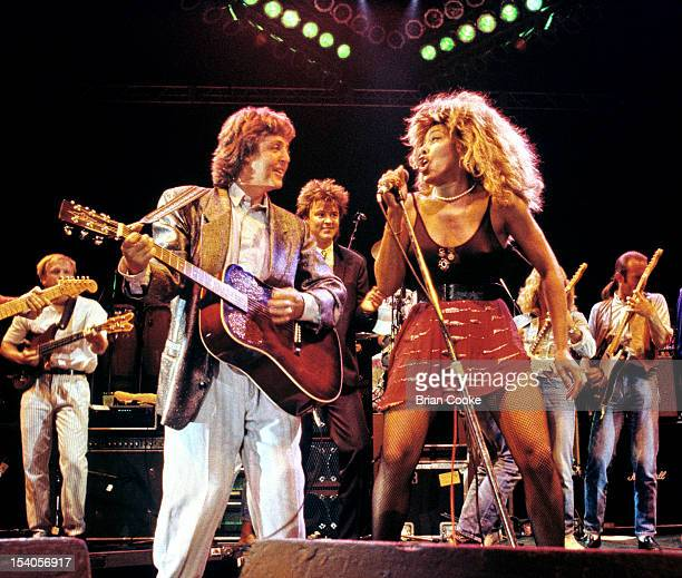 Paul McCartney and Tina Turner performing on stage at The Prince's Trust 10th Birthday Party at Wembley Arena London United Kingdom on 20th June 1986...