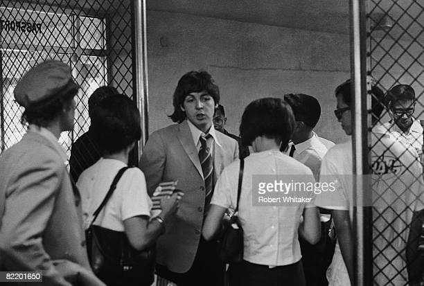 Paul McCartney at Manila International Airport after the Philippines leg of the Beatles' final world tour 5th July 1966 The group made a hasty exit...