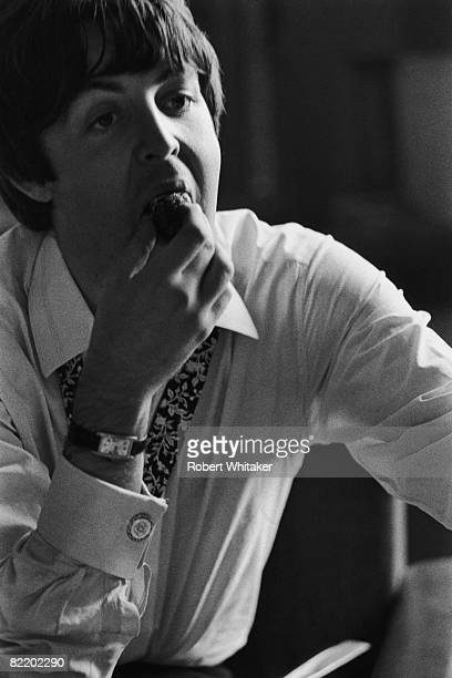 Paul McCartney eats a strawberry after the Beatles' second press conference at the Bayerische Hof Hotel in Munich at the start of the Beatles' final...