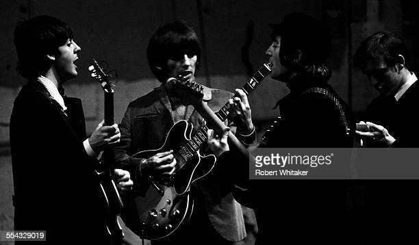 Paul McCartney George Harrison John Lennon and Neil Aspinall are pictured at the Donmar Rehearsal Theatre in central London during rehearsals for The...