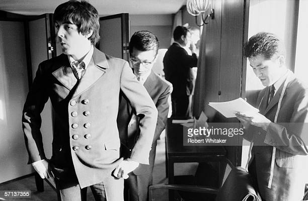 Paul McCartney has his suit taken out by a tailor at the Tokyo Hilton during the Beatles' Asian tour 30th June 1966