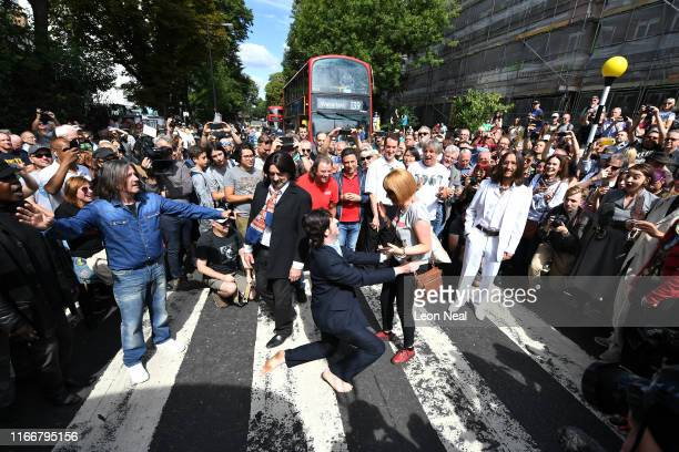 Paul McCartney impersonator proposes to his girlfriend as a group of Beatles lookalikes recreate the iconic 'Abbey Road' photograph made 50 years ago...
