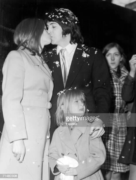 Paul McCartney kissing his bride Linda during their wedding at Marylebone registry office Linda's daughter Heather stands with them 12th March 1969
