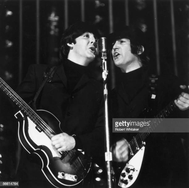 Paul McCartney left and John Lennon of the Beatles giving a concert at the Hammersmith Odeon London 17th December 1965