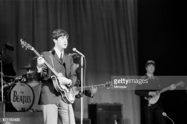 Paul McCartney of The Beatles as they rehearse at The Prince of Wales Theatre in London for The Royal Variety Command Performance due to take place...