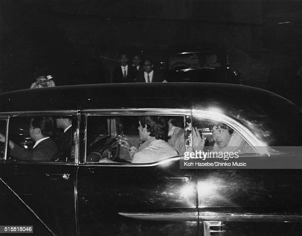 Paul McCartney of The Beatles being driven back to the hotel after the band's 3rd concert at Budokan Tokyo Japan July 1 1966
