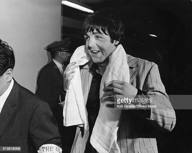 Paul McCartney of The Beatles dries off with a towel while returning to the hotel after the band's 3rd concert at Budokan Tokyo Japan July 1 1966