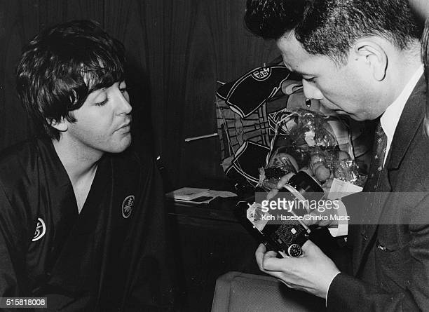 Paul McCartney of the Beatles examines a camera during an interview for Japanese music magazine 'Music Life' Tokyo Hilton Hotel Japan July 2 1966